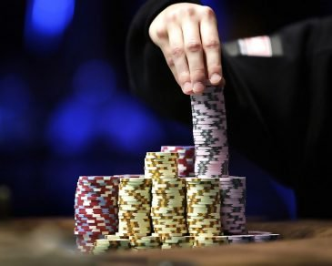 gambler-stacks-his-chips-during-the-finals-of-world-series-of-poker-main-event-at-the-rio-hotel-casino-in-las-vegas